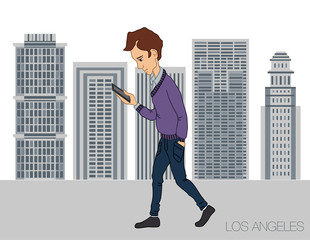 young man strolling through the city with a mobile phone