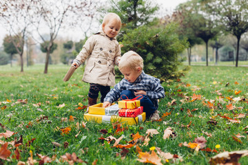 Happy children with gift in the park