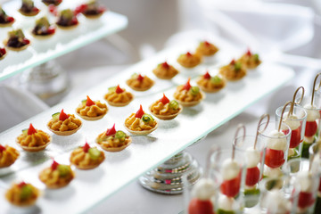 Plates with assorted snacks on an event party