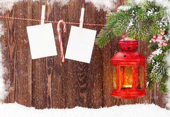 Christmas candle lantern and blank photos