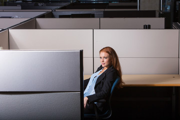 serious business woman working in her cubicle
