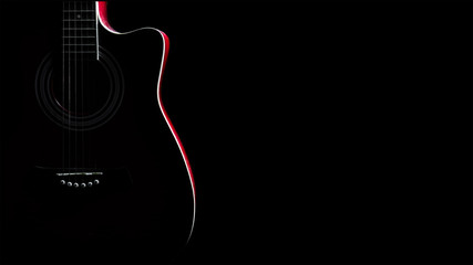 Guitar silhouette in the dark