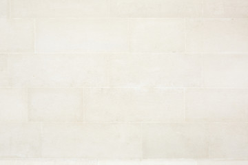 Beige tiled stone wall texture background