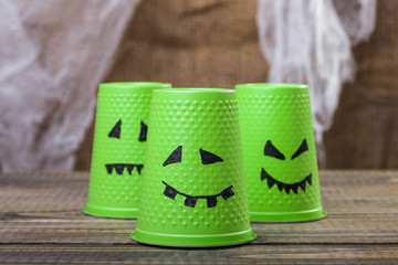 Disposable cups with ghost smiles