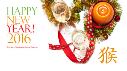 New year greeting card made of two glasses of champagne, yellow and green tinsel with red christmas balls, red ribbon with snowflakes and orange candle with chinese hieroglyph for monkey