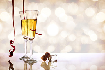 Two glasses of sparkling white wine and cork horizontal