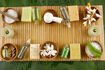 Row of setting tropical spa on bamboo mat