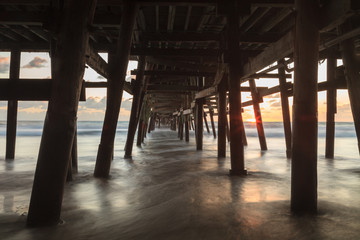 Under the San Clemente pier at sunset in the fall