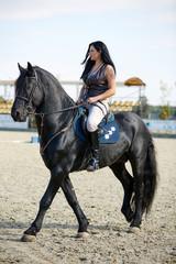 Woman astride a horse