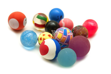 Colored small balls on a white background