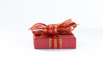 Small gift box placed in white isolated background