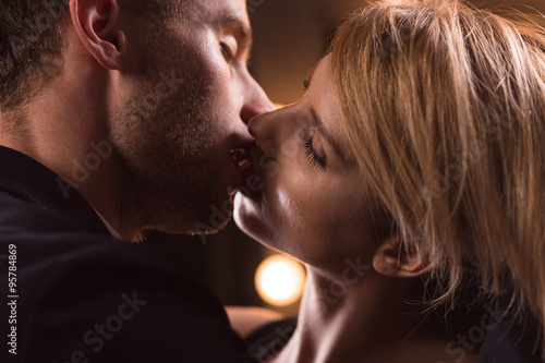 "French Kiss Couple Images handsome couple having french kiss"" stock photo and royalty-free"