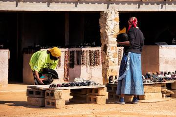 saleswoman of African art