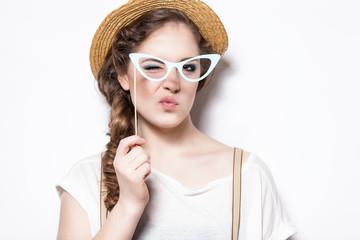 Portrait of funny Hipster Girl, studio shot