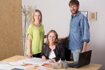 Three people working together