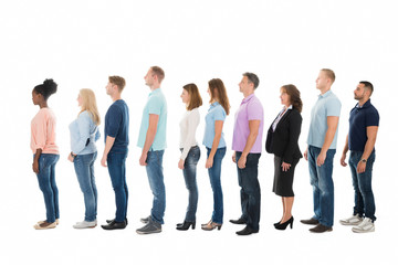 Side View Of Creative Business People Standing In Row