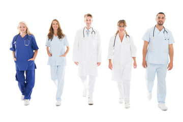 Portrait Of Confident Medical Team Walking In Row