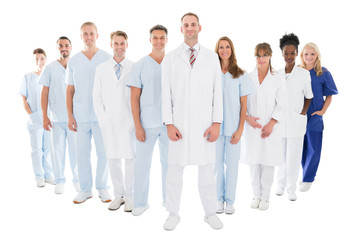 Portrait Of Confident Doctor Standing With His Team