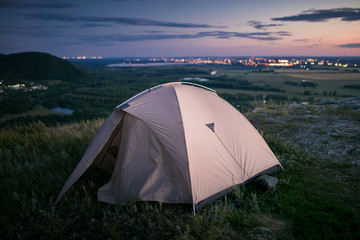 Tent and city lights