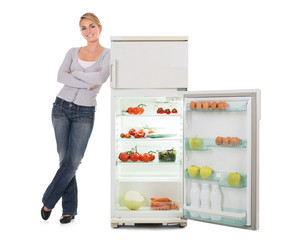 Woman With Arms Crossed Leaning On Open Refrigerator