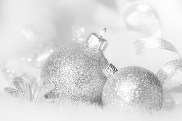 Christmas silver baubles in white and black abstract closeup