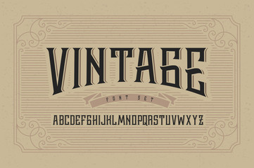 Vintage font set on cardboard texture vector background with decorative ornate frame.