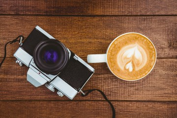 Wall Mural - View of an old camera with coffee