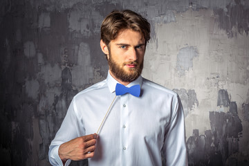 Young man holding blue paper bow-tie