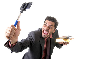 businessman taking selfie photo with mobile phone camera and sti