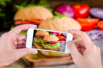 Hands taking photo burgers with smartphone