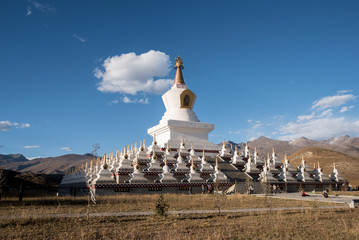 Holy white stupas at Daocheng, Yunnan province, China.
