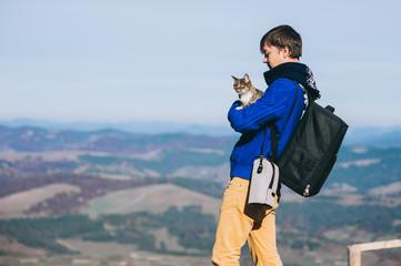 tourist and cat mountain autumn