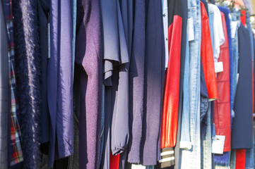 Clothes for sale in a street market. Color image
