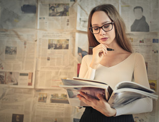 Girl reading magazines