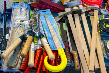 Hammers, saws, axes and other work tools for sale in a market in the Puglia region. Italy