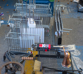 Objects for the barbecue in stainless steel and iron sale in a market in the Puglia region. Italy