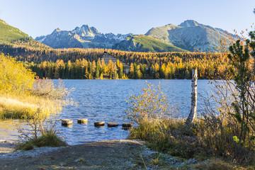 Autumn colored mountain lake on sunrise, Strbske lake, High Tatras, Slovakia