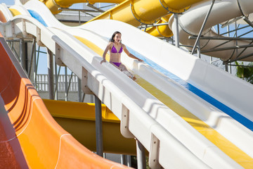 girl in bikini sliding water park