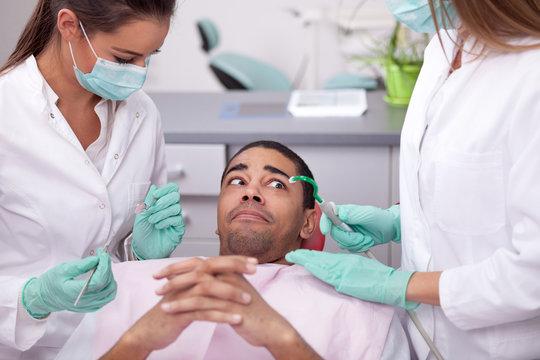 dentist curing a girls teeth