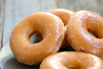 Glazed donuts background image. Macro with shallow dof.