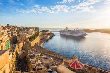 The ancient walls of Valletta and Malta harbor with cruise ship in the morning - Malta