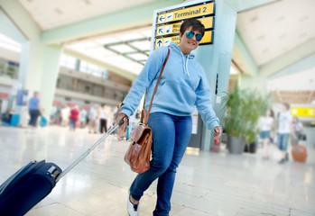 Business Woman Traveler Rushing Through the Airport Terminal to