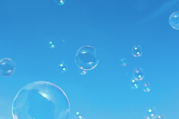 bubbles against the blue sky with clouds