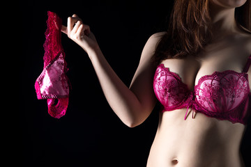 Woman in lingerie holding panties