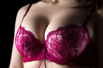 Woman's breast on black background