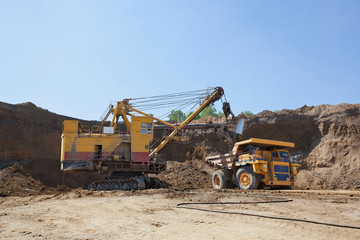 Coal mining. The dredge loads the truck ground.