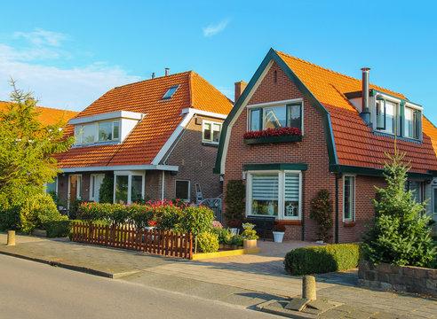Picturesque residential houses in small Dutch town Zwanenburg, t