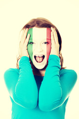 Woman with Italian flag on face.