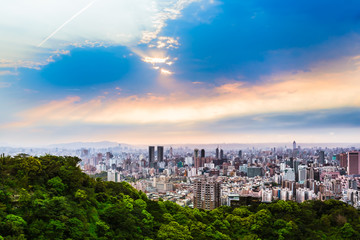 Taipei Outskirts View at Evening / Cloudy twilight sky at an spring evening with sunshine rays at wide cityscape outskirts of Taipei, Taiwan
