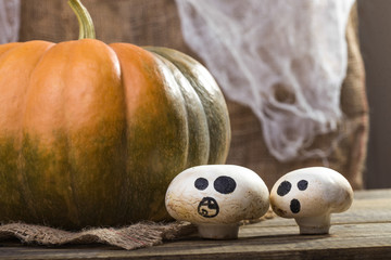 Halloween pumpkin with ghost champignons
